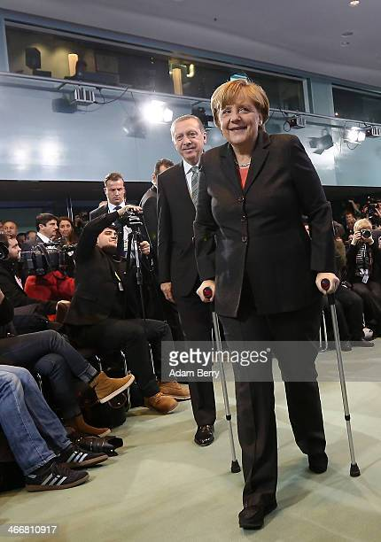 German Chancellor Angela Merkel and Turkish Prime Minister Recep Tayyip Erdogan arrive to speak to the media following talks at the German federal...