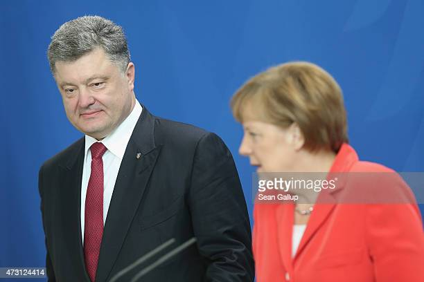 German Chancellor Angela Merkel and Ukrainian President Petro Poroshenko arrive to give statements to the media prior to talks at the Chancellery on...