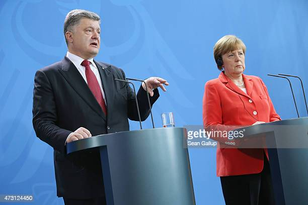 German Chancellor Angela Merkel and Ukrainian President Petro Poroshenko give statements to the media prior to talks at the Chancellery on May 13...