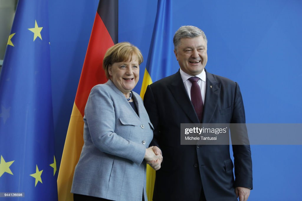 German Chancellor Angela Merkel (CDU) and Ukrainian President Petro Poroshenko speak to the media representatives during a joint press conference after their meeting in the German chancellery on April 10, 2018 in Berlin, Germany.Germany keeps acting as intermediary between Ukraine and Russia still searching for a diplomatic solution in the East Ukraine crisis following the Minsk treaty.