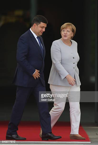 German Chancellor Angela Merkel and Ukrainian Prime Minister Volodymyr Groysman chat upon Groysman's arrival at the Chancellery on June 27 2016 in...