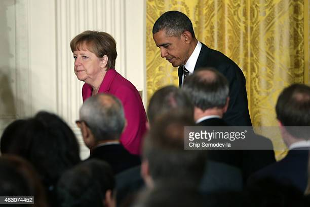 German Chancellor Angela Merkel and US President Barack Obama arrive to a joint news conference in the East Room after meetings about the situation...