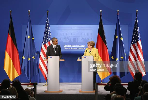 German Chancellor Angela Merkel and US President Barack Obama speak to the media following talks at Schloss Herrenhausen palace on Obama's first day...