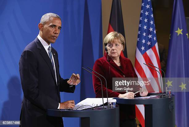 German Chancellor Angela Merkel and US President Barack Obama speak to the media following talks at the Chancellery on November 17 2016 in Berlin...