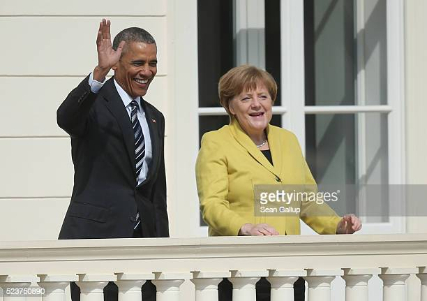 German Chancellor Angela Merkel and US President Barack Obama wave upon Obama's arrival at Schloss Herrenhausen palace on April 24 2016 in Hanover...