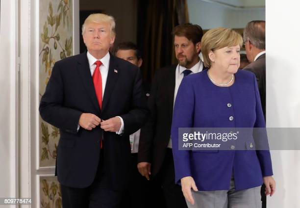 German Chancellor Angela Merkel and US President Donald Trump arrive for a bilateral meeting on the eve of the G20 summit in Hamburg northern Germany...
