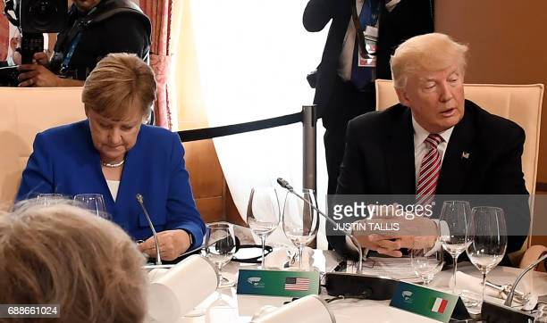 German Chancellor Angela Merkel and US President Donald Trump attend a working lunch during the Summit of the Heads of State and of Government of the...