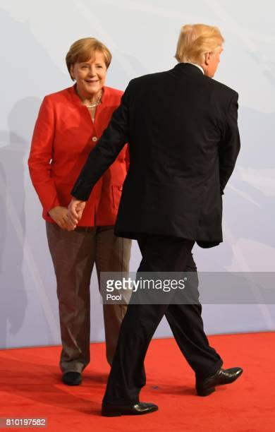 German Chancellor Angela Merkel and US President Donald Trump attend the G20 summit on July 7, 2017 in Hamburg, Germany. Leaders of the G20 group of...