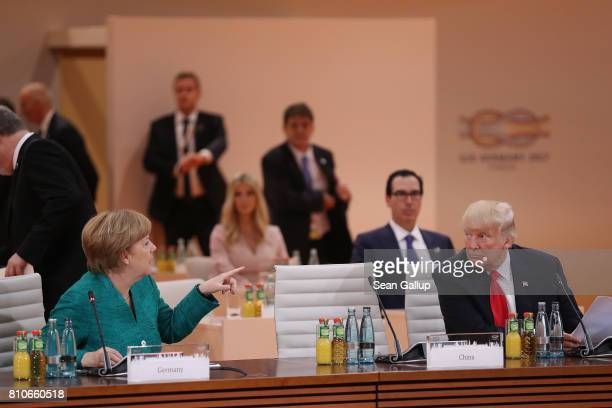 German Chancellor Angela Merkel and US President Donald Trump attend the morning working session on the second day of the G20 economic summit on July...