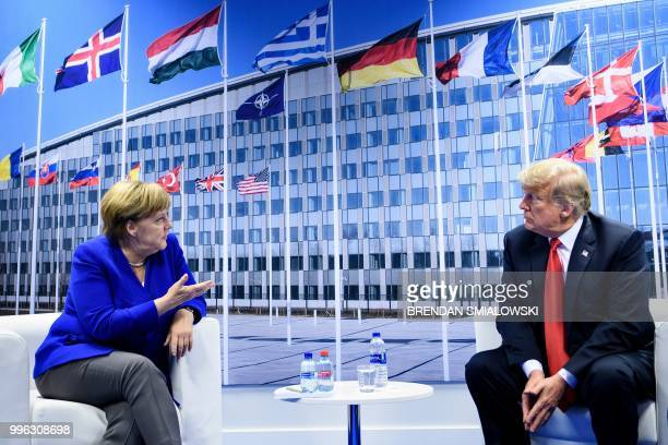 TOPSHOT German Chancellor Angela Merkel and US President Donald Trump make a statement to the press after a bilateral meeting on the sidelines of the...