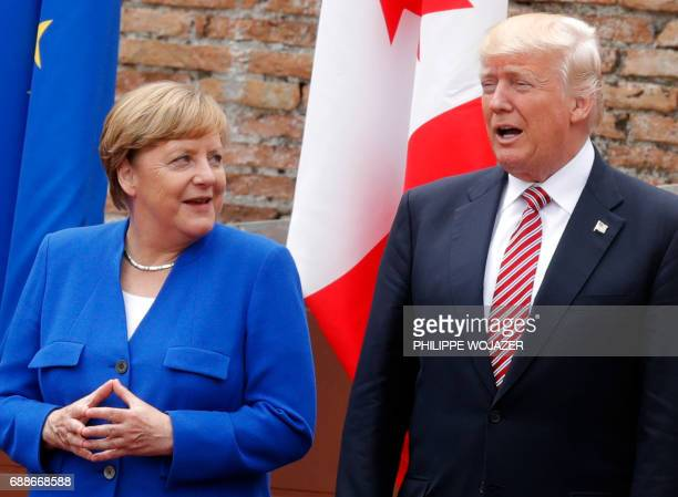 German Chancellor Angela Merkel and US President Donald Trump pose for a family picture as they attend the Summit of the Heads of State and of...