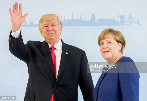 German Chancellor Angela Merkel and US President Donald Trump pose prior to a bilateral meeting on the eve of the G20 summit in Hamburg northern...