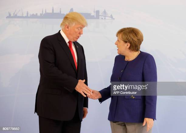 German Chancellor Angela Merkel and US President Donald Trump shake hands prior to a bilateral meeting on the eve of the G20 summit in Hamburg...