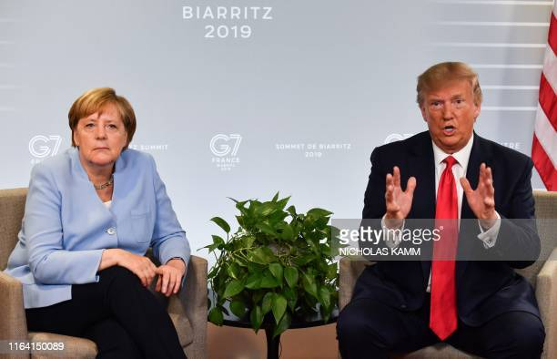 German Chancellor Angela Merkel and US President Donald Trump speak during a bilateral meeting in Biarritz southwest France on August 26 on the third...