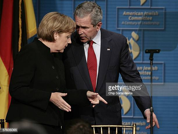 German Chancellor Angela Merkel and US President George W Bush attend the American Jewish Committee's 100th Anniversary Gala at the National Building...