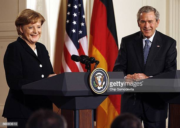 German Chancellor Angela Merkel and US President George W Bush hold a joint press conference in the East Room of the White House January 13 2006 in...
