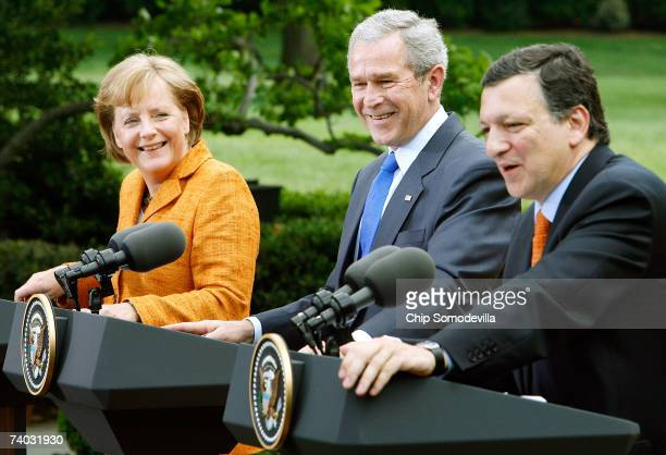 German Chancellor Angela Merkel and US President George W Bush share a laugh with European Commission President Jose Manuel Barroso during a news...