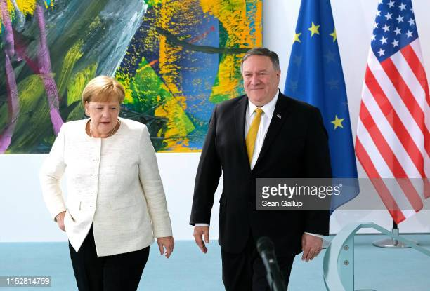 German Chancellor Angela Merkel and U.S. Secretary of State Mike Pompeo arrive to give statements to the media prior to talks at the Chancellery on...