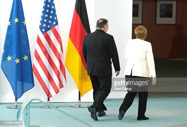 German Chancellor Angela Merkel and U.S. Secretary of State Mike Pompeo depart after giving statements to the media prior to talks at the Chancellery...