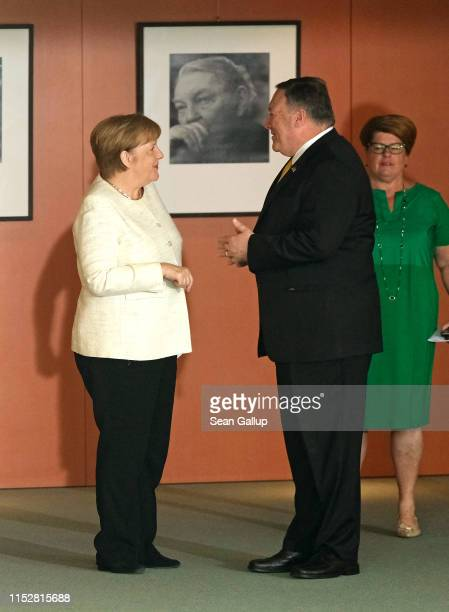German Chancellor Angela Merkel and U.S. Secretary of State Mike Pompeo chat prior to giving statements to the media before talks at the Chancellery...
