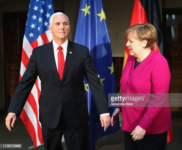 German Chancellor Angela Merkel and US vice president Michael Pence are pictured during a photo call ahead of bilateral talks during the 55th Munich...