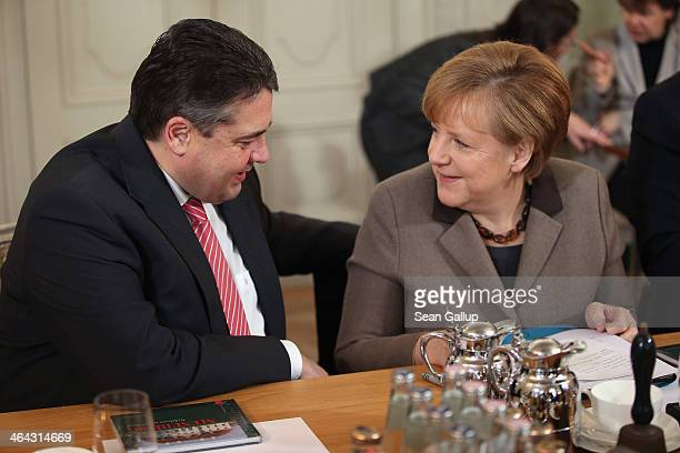 German Chancellor Angela Merkel and Vice Chancellor and Economy and Energy Minister Sigmar Gabriel chat prior to the first meeting of the German...