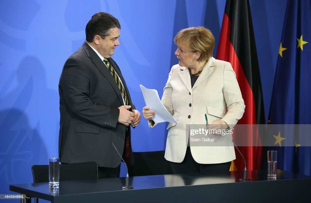 German Chancellor Angela Merkel and Vice Chancellor and Economy and Energy Minister Sigmar Gabriel prepare to depart after speaking to journalists following two days of meetings of the German government cabinet at Schloss Meseberg palace on January 23, 2014 in Meseberg, Germany. The government cabinet of Christian Democrats and Social Democrats was on a two-day retreat at Meseberg.