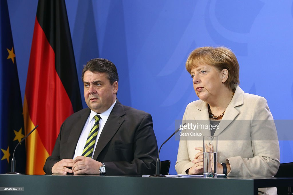 German Chancellor Angela Merkel and Vice Chancellor and Economy and Energy Minister Sigmar Gabriel speak to journalists following two days of meetings of the German government cabinet at Schloss Meseberg palace on January 23, 2014 in Meseberg, Germany. The government cabinet of Christian Democrats and Social Democrats was on a two-day retreat at Meseberg.
