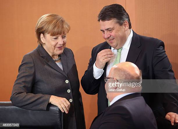 German Chancellor Angela Merkel and Vice Chancellor and Economy and Energy Minister Sigmar Gabriel chat with Minister of the Chancellery Peter...