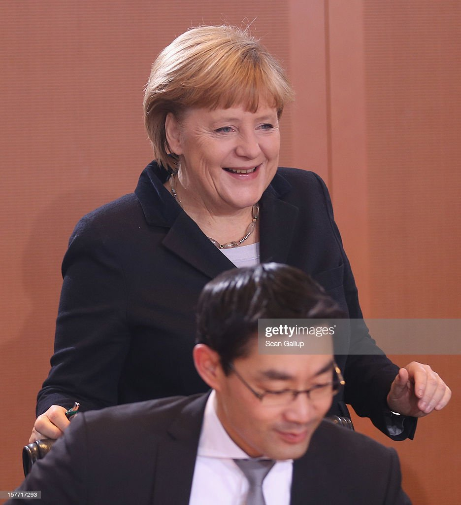 German Chancellor Angela Merkel and Vice Chancellor and Economy Minister Philipp Roesler arrive for the weekly German government cabinet meeting on December 6, 2012 in Berlin, Germany. The German and Israeli governments are meeting later in the day for German-Israeli government consultations.