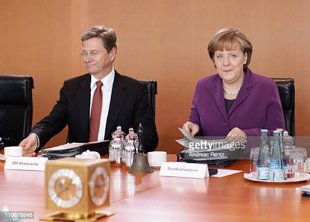 German Chancellor Angela Merkel and Vice Chancellor and Foreign Minister Guido Westerwelle attend the weekly German government cabinet meeting at the...