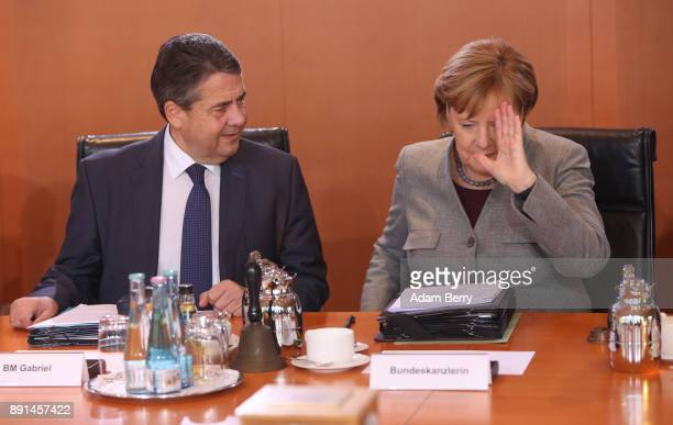 German Chancellor Angela Merkel and Vice Chancellor and Foreign Minister Sigmar Gabriel arrive for the weekly German federal Cabinet meeting on...