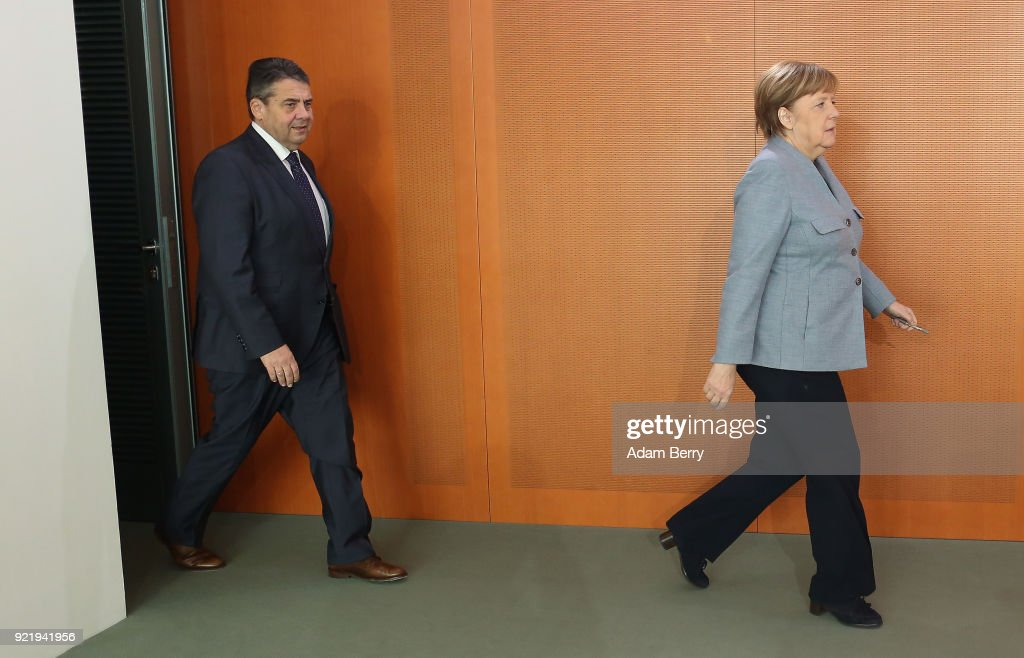 German Chancellor Angela Merkel (CDU, R) and Vice Chancellor and Foreign Minister Sigmar Gabriel (SPD) arrive for the weekly German federal Cabinet meeting on February 21, 2018 in Berlin, Germany. High on the meeting's agenda was discussion of legislation of volume levels of outdoor screenings of upcoming World Cup matches.
