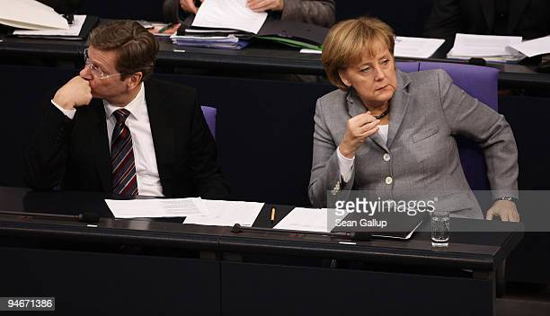 German Chancellor Angela Merkel and Vice Chancellor and Foreign Minister Guido Westerwelle follow debates after Merkel gave a government declaration...