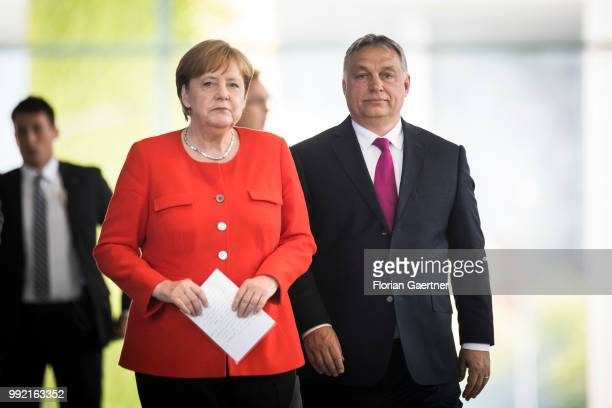German Chancellor Angela Merkel and Viktor Orban Prime Minister of Hungary arrive for a press conference on July 05 2018 in Berlin Germany They get...