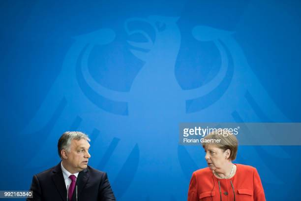 German Chancellor Angela Merkel and Viktor Orban Prime Minister of Hungary are pictured during a press conference on July 05 2018 in Berlin Germany...