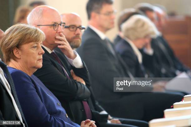 German Chancellor Angela Merkel and Volker Kauder attend the memorial service for the late German politician Heiner Geissler at St Hedwig Cathedral...
