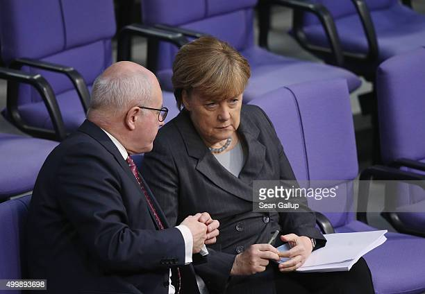 German Chancellor Angela Merkel and Volker Kauder head of the Bundestag faction of the German Christian Democrats attend debates prior to a vote at...
