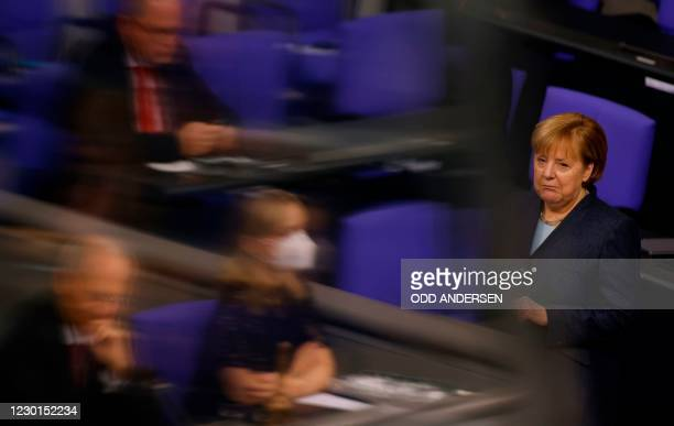 German Chancellor Angela Merkel answers MPs' questions regarding the coronavirus Covid-19 pandemic on December 16 at the Bundestag in Berlin.