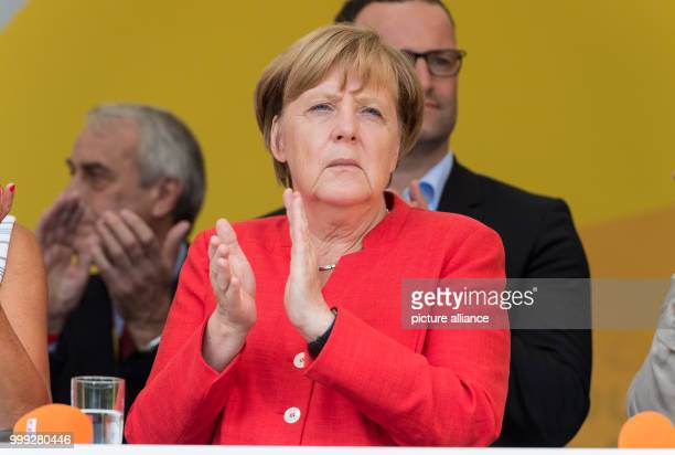 German Chancellor Angela Merkel  applauds during her election campaign tour in North RhineWestphalia in Muenster Germany 22 August 2017 Photo Guido...