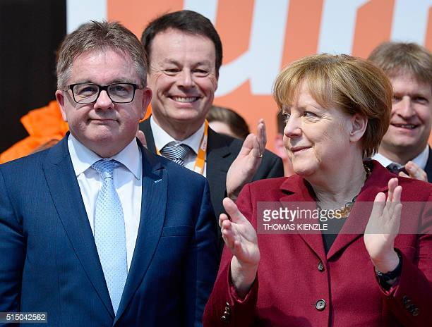 German Chancellor Angela Merkel applauds Guido Wolf top candidate of the Christian Democratic Union for the state elections in German state...