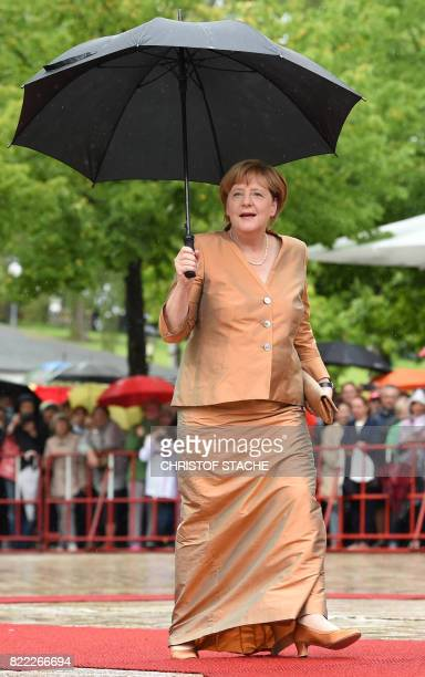 German chancellor Angela Merkel arrives at the Festival Theatre on July 25 in Bayreuth southern Germany ahead of the opening of Bayreuth's legendary...