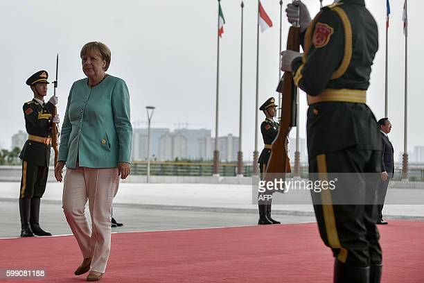 German Chancellor Angela Merkel arrives at the Hangzhou International Expo Center to attend the G20 Summit in Hangzhou on September 4, 2016. World...