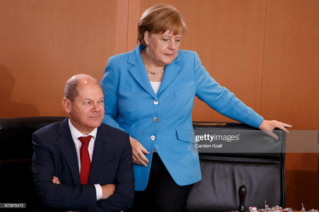 German Chancellor Angela Merkel arrives beside Minister of Work and Social Affairs Hubertus Heil for the weekly government cabinet meeting on June 13, 2018 in Berlin, Germany. High on the morning's agenda is labour legislation intended to ease workers' transition from part-time to full-time work.