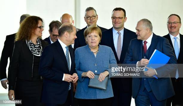 German Chancellor Angela Merkel arrives for a handover ceremony of the annual report of the German Council of Economic Experts on the country's...