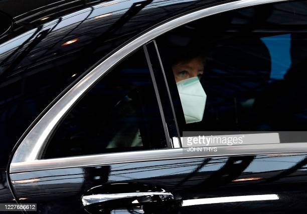 German Chancellor Angela Merkel arrives for a meeting of an EU summit on a coronavirus recovery package at the European Council building in Brussels...