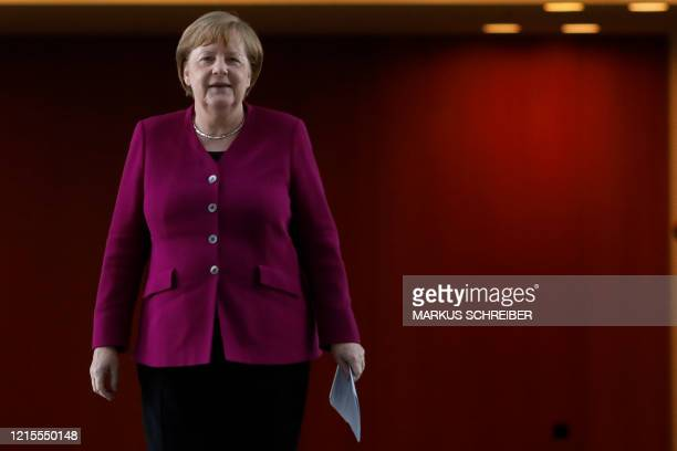 German Chancellor Angela Merkel arrives for a news conference after a meeting with governors of eastern German states at the Chancellery in Berlin...