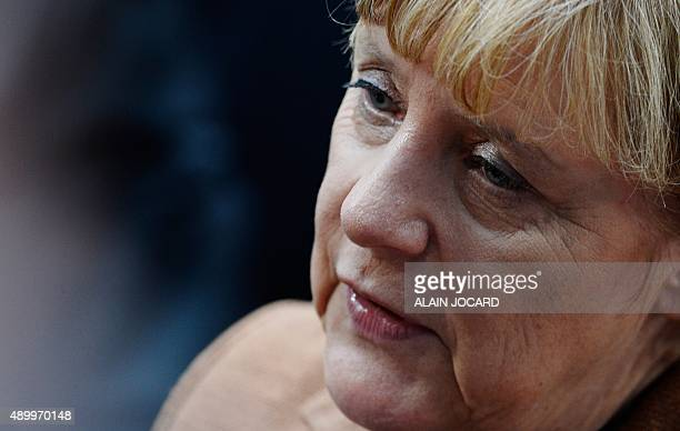 German Chancellor Angela Merkel arrives for an extraordinary summit on the migrants crisis in Europe on September 23 in Brussels AFP PHOTO / ALAIN...