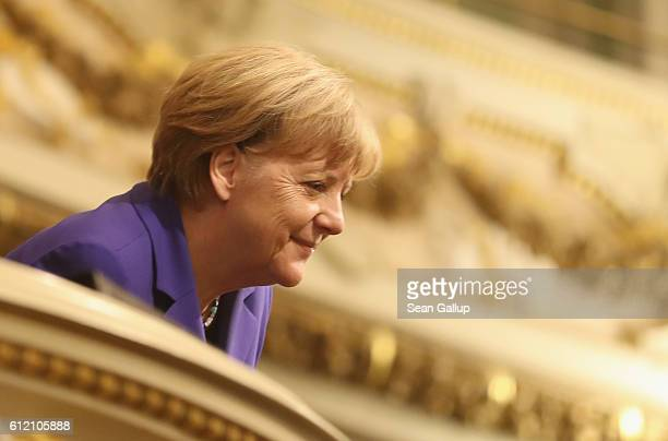 German Chancellor Angela Merkel arrives for celebrations to mark German Unity Day at the Semperoper opera house on October 3 2016 in Dresden Germany...