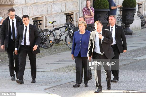 German Chancellor Angela Merkel arrives for the memorial service for the late German politician Heiner Geissler at St Hedwig Cathedral on October 17...